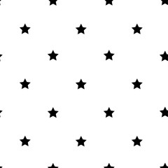 Little black stars on a white background seamless pattern