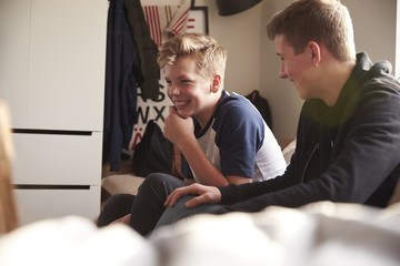 Two Teenage Boys Hanging Out In Bedroom Together