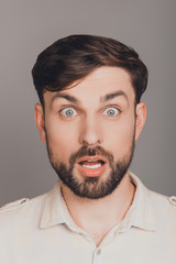 Portrait of shocked young guy with open mouth