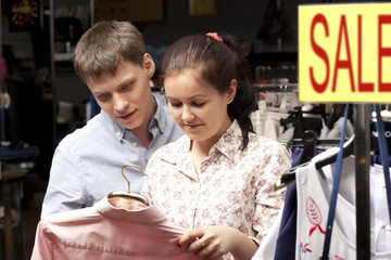 A happy young couple shopping