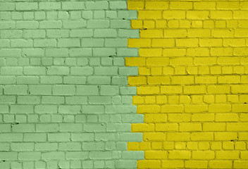 Light Green and Yellow Brick Wall