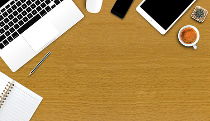 office supplies and gadgets on a wooden table background [view from above]