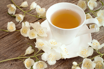 Herbal tea  and blooming flowers