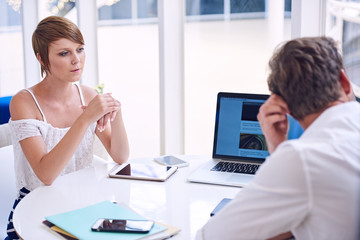 Apparent disagreement between male and female partners during business meeting