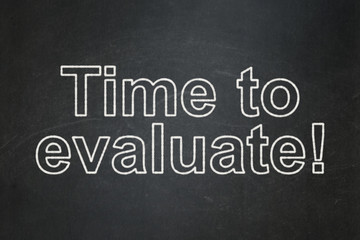 Time concept: Time to Evaluate! on chalkboard background