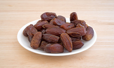 Tunisian pitted dates on a plate side view