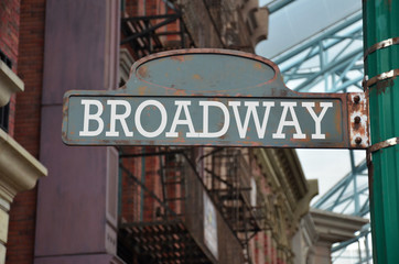 Street sign on the corner of Broadway