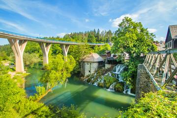 Bridge over Korana river canyon and beautiful village of Rastoke near Slunj in Croatia, old water mills on waterfalls, beautiful countryside landscape