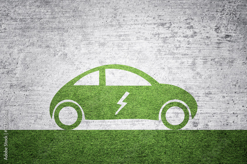 Electric car background. Green grass textured flat car icon with electric symbol on grunge textured illustration background.