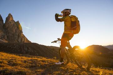 Mountain bike athletes drinking energy drink
