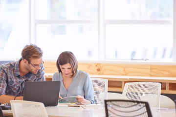 business man and woman working together with copy space