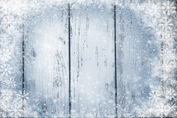 Color wooden background with snow effect