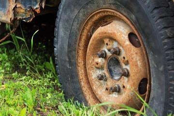 old vintage rusty car wheel