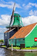 Traditional Dutch old wooden windmill. Zaanse Schans, Zaandam.