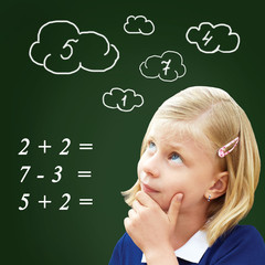 Pupil thinks standing at the blackboard. The child decides to examples in mathematics