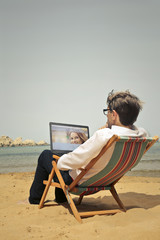 Employee using a laptop at the beach