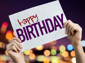 Happy Birthday placard with night lights on background