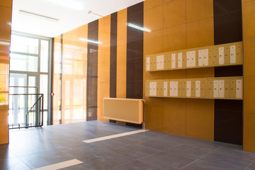 Entrance in modern building with mailboxes