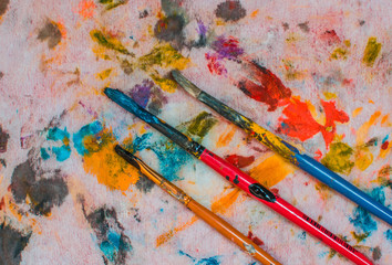 brush on a colorful background