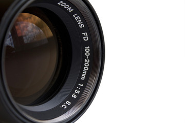 Detail of the old zoom lens on a camera, white background, large space for text
