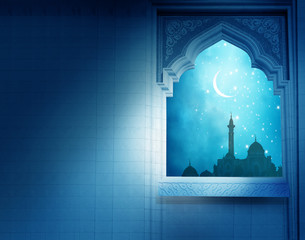 Eid Mubarak greeting background .Mosque window with shiny crescent moon