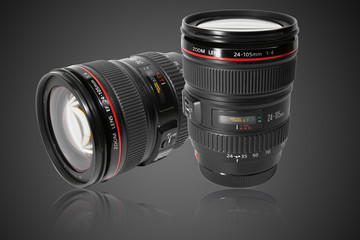 Two camera lens on studio gray background