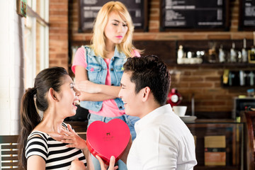 ex girlfriend being jealous on couple in cafe