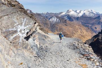 Backpacker hiking people mountain trail, Bolivia tourism.