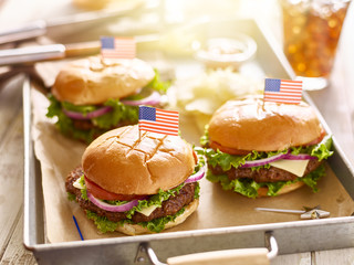 cheese burgers on tray with flags in 4th of july theme