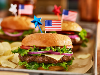 cheesebuergers in tray with potato chips patriotic american theme