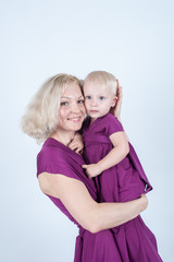Blonde mom and daughter in Studio on white background