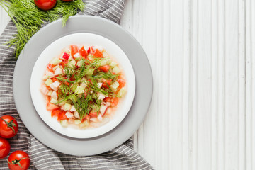 Salad of cucumber, tomato, dill and olive oil