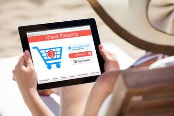 Woman Shopping Online At Beach