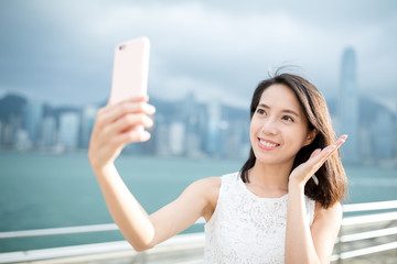 Asian woman take selfie with cellphone