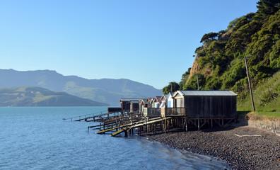 Boat Houses on Akaroa Harbour, New Zealand.