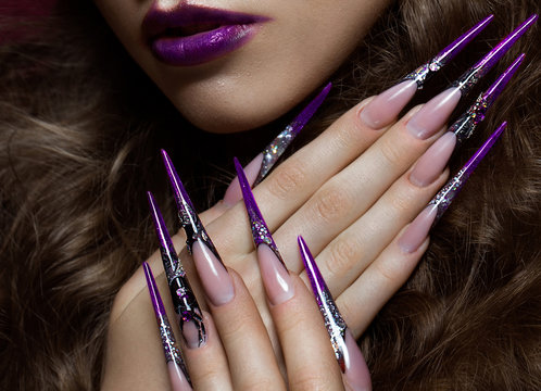 Portrait of woman with creative art makeup and long nails. Manicure design, beauty face.