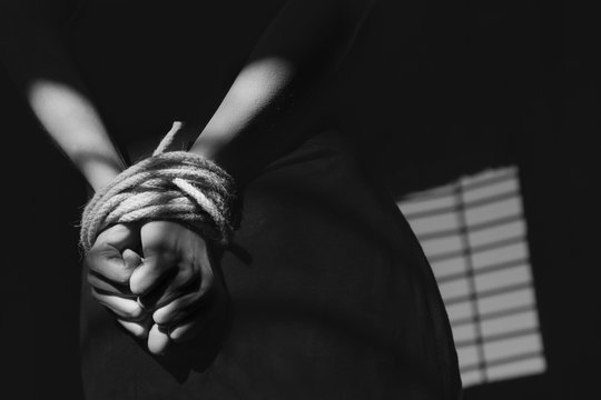 woman tied and imprisoned