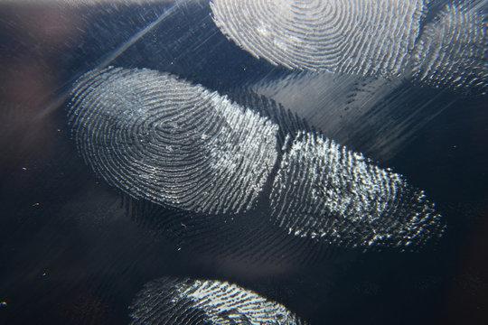 finger print on screen and hand finger