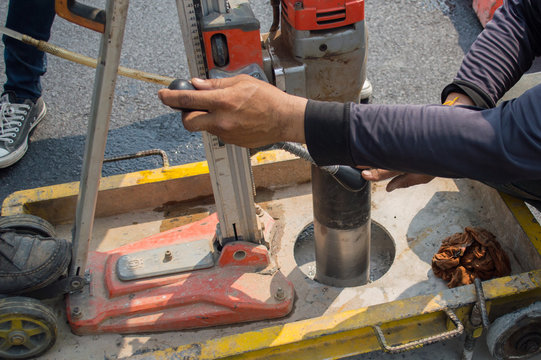 Testing for wearing course thickness using Coring