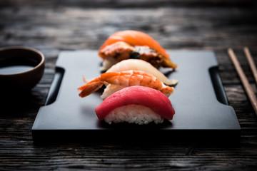 Aluminium Prints Sushi bar sashimi sushi set with soy on black background