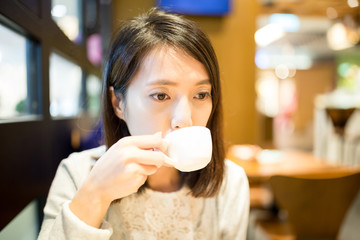 Woman drink of coffee in cafe