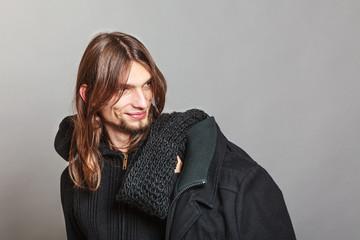 Handsome fashion man portrait wearing black coat.