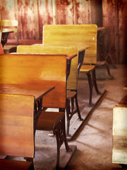 Old fashioned wooden desks in a schoolhouse