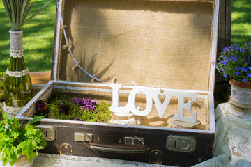 Decorated wagon with vases, flowers and handmade things for fash