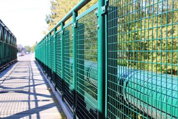Detail of green railing at empty bridge