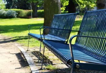 Detail of blue bench at spring park