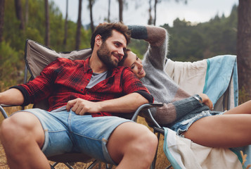 Loving young couple camping in nature