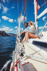 Couple  sitting together on the deck of a yacht