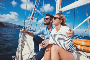 Loving young couple having vacation on a yacht