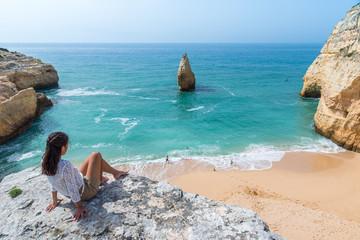 Girl at beautiful beach Carvalho of Algarve, Portugal
